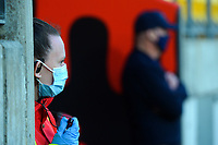 A masked security guard watches the third international men's T20 cricket match between the New Zealand Black Capss and Australia at Sky Stadium in Wellington, New Zealand on Wednesday, 3 March 2021. Photo: Dave Lintott / lintottphoto.co.nz