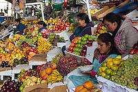Peru, Cusco, San Pedro Market.  Peruvian Women Selling Fresh Fruit.