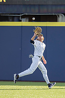 Michigan Wolverines outfielder Jordan Brewer (22) makes a catch during the NCAA baseball game against the Eastern Michigan Eagles on May 8, 2019 at Ray Fisher Stadium in Ann Arbor, Michigan. Michigan defeated Eastern Michigan 10-1. (Andrew Woolley/Four Seam Images)