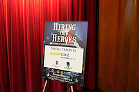 A Hiring Our Heroes placard stands at the Recovering Warrior Employment Conference at the Back Bay Event Center in Boston, Massachusetts, USA. <br /> <br /> The employment conference was organized by Hiring Our Heroes and Wounded Warrior Project. Hiring Our Heroes is an initiative of the US Chamber of Commerce Foundation. Approximately 40 veterans registered for the event, during which they had interviews with a number of different regional and national employers, including GE, Bank of America, Uber, and others.