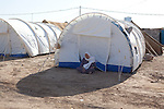 DOMIZ, IRAQ: An old woman sits in the shade of her tent in the Domiz refugee camp...Over 7,000 Syrian Kurds have fled the violence in Syria and are living in the Domiz refugee camp in the semi-autonomous region of Iraqi Kurdistan...Photo by Ali Arkady/Metrography