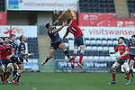Ospreys centre Josh Matavesi and Munster wing Ronan O'Mahony compete for the high ball.<br /> Guiness Pro12<br /> Ospreys v Munster<br /> Liberty Stadium<br /> 07.03.15<br /> ©Steve Pope - SPORTINGWALES