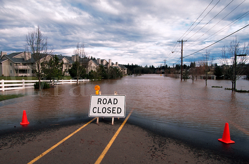 Suburban neighborhood under flood waters with a 'Road Closed' sign. Tualatin, Oregon.