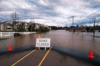 Suburban neighborhood under flood waters with a 'Road Closed' sign. Tualatin, Oregon.
