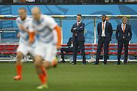 Netherlands manager Louis van Gaal watches Wesley Sneijder and Arjen Robben warm up