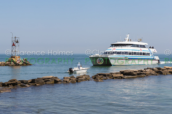 A Hy-Line Cruises high-speed ferry from Hyannis to Martha's Vineyard enters Oak Bluffs Harbor in Oak Bluffs, Massachusetts.