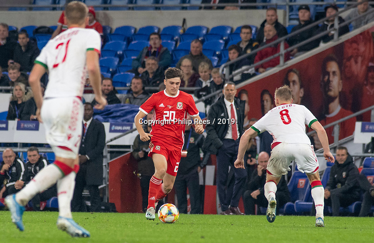 Cardiff - UK - 9th September :<br />Wales v Belarus Friendly match at Cardiff City Stadium.<br />Daniel James takes the ball forward for Wales as Manager Ryan Giggs looks on.<br />Editorial use only