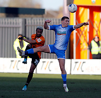 Mauro Vilhete (L) of Barnet is challenged by Lewis Hardcastle during Barnet vs Barrow, Buildbase FA Trophy Football at the Hive Stadium on 8th February 2020