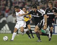 30 October,  2004.   MetroStars midfielder Amado Guevara (20) tries get past Ryan Nelsen (7) of DC United during the 2004 MLS playoffs at RFK Stadium in Washington, DC.