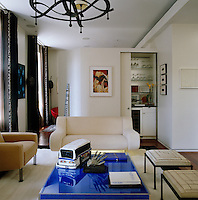 At one end of the small apartment the partition wall opens to reveal a room beyond