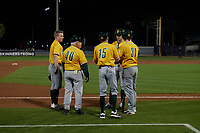 Siena Saints head coach Tony Rossi (40) talks with Pat O'Hare (17), Anthony Spataro (15), Jake Hall (14), and Bryce Mordecki (31) during a game against the UCF Knights on February 14, 2020 at John Euliano Park in Orlando, Florida.  UCF defeated Siena 2-1.  (Mike Janes/Four Seam Images)