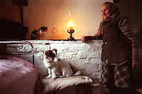 Belarus/Weissrussland, 2005/03/25<br /> BARTOLOMEYKA - A look into the home of Elena Nikitevna reminds one of the 19th century. A couple of old people still live in this village of Bartolomeyka (Gomel region, Belarus), which has been heavily contaminated by Chernobyl fallout. Contamination by Cesium 137 is higher than 70 Curie per square kilometer here. The village had to be evacuated and most of the houses were torn down. Despite the danger, some people went back wishing to spent the rest of their life there. They have no electricity but this does not keep them from being happy.<br /> ? Vaclav Vasku/EST&OST