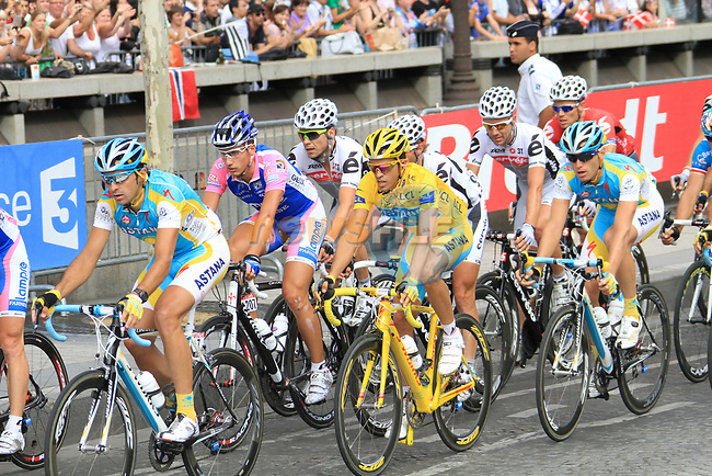 The chasing peloton including Yellow Jersey leader Alberto Contador (ESP) Astana on the Champs-Elysees during the final Stage 20 of the 2010 Tour de France running 102.5km from Longjumeau to Paris Champs-Elysees, France. 25th July 2010.<br /> (Photo by Eoin Clarke/NEWSFILE).<br /> All photos usage must carry mandatory copyright credit (© NEWSFILE | Eoin Clarke)