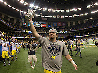 Michigan defensive lineman Ryan Van Bergen is pictured holding up Sugar Bowl Trophy after winning the game against Virginia Tech at Mercedes-Benz SuperDome in New Orleans, Louisiana on January 3rd, 2012.  Michigan defeated Virginia Tech, 23-20 in first overtime.