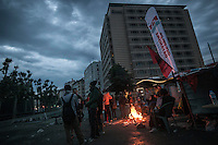 Protesters gather around fire outside Divan hotel as down rises up in Gazi park of Taksim Square during a 24/7 masive rally against the turkish government in Istanbul, Turkey.