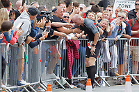 Pictured: Gareth Thomas breaks down in tears after being embraced by his husband Stephen minutes after he started his marathon run. Sunday 15 September 2019<br /> Re: Ironman triathlon event in Tenby, Wales, UK.