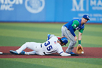 Chris Fornaci (1) of the Lexington Legends fields a throw as Cesar Trejo (35) of the High Point Rockers steals second base at Truist Point on June 16, 2021, in High Point, North Carolina. The Legends defeated the Rockers 2-1. (Brian Westerholt/Four Seam Images)