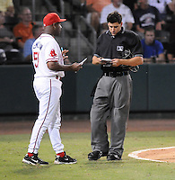 Manager Billy McMillon (51) of the Greenville Drive finds out who was ejected from home plate umpire Derrick Mollica in Game 2 of the South Atlantic League Championship Series against the Lakewood BlueClaws on Sept. 14, 2010, at Fluor Field at the West End in Greenville, S.C. Photo by: Tom Priddy/Four Seam Images
