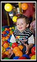 03/05/2009  Copyright  Pic : James Stewart.06_the_buzz.**** FREE FIRST USE WHEN USED IN RELATION TO  OPENING OF THE BUZZ ****.THE UK'S LARGEST SOFT PLAY AND LASER QUEST ARENA OPENS IN FALKIRK...... .LOGAN RUSSELL (3) HAS FUN IN THE BALL PIT....For more information contact Jonathan Kennedy or Alison Jack at Wave PR on 0141 303 8390 / 07803 137262..James Stewart Photography 19 Carronlea Drive, Falkirk. FK2 8DN      Vat Reg No. 607 6932 25.Telephone      : +44 (0)1324 570291 .Mobile              : +44 (0)7721 416997.E-mail  :  jim@jspa.co.uk.If you require further information then contact Jim Stewart on any of the numbers above.........