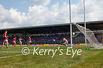 Paudie Clifford, Kerry, has a shot at goal blocked by Mícheál  Martin, Cork, during the Munster GAA Football Senior Championship Final match between Kerry and Cork at Fitzgerald Stadium in Killarney on Sunday.