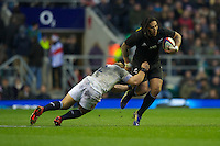 Ma'a Nonu of New Zealand is tackled by Tom Youngs of England during the QBE Autumn International match between England and New Zealand at Twickenham on Saturday 01 December 2012 (Photo by Rob Munro)