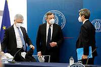The Minister of Economy Daniele Franco, the Italian premier Mario Draghi and  the Minister of Health Roberto Speranza during the press conference at the end of the Minister's cabinet.<br /> Rome (Italy), March 19th 2021<br /> Photo Samantha Zucchi Insidefoto