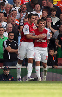 Pictured: Andrey Arshavin of Arsenal (R) celebrating his goal with team mate. Saturday 10 September 2011<br />