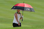 CHON BURI, THAILAND - FEBRUARY 19: Karen Stupples of England shelters from the sun under an umbrella on the 18th hole during day three of the LPGA Thailand at Siam Country Club on February 19, 2011 in Chon Buri, Thailand. Photo by Victor Fraile / The Power of Sport Images