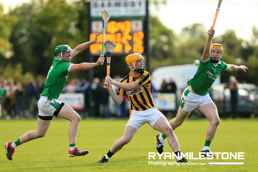 EVENT:<br /> Mid Tipperary Senior Hurling Final<br /> Upperchurch-Drombane vs Drom-Inch<br /> Sunday 29th September 2019,<br /> Littleton, Tipperary<br /> <br /> CAPTION:<br /> Loughlin Ryan of Upperchurch-Drombane in action against Johnny Ryan and Podge Campion of Drom-Inch<br /> <br /> Photo By: Michael P Ryan