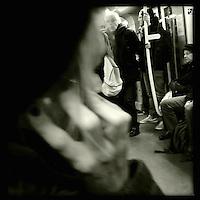 Eine Frau in der U-Bahn. Berlin Streetviews<br />25.11.2013, Berlin<br />Copyright: Christian-Ditsch.de<br />[Inhaltsveraendernde Manipulation des Fotos nur nach ausdruecklicher Genehmigung des Fotografen. Vereinbarungen ueber Abtretung von Persoenlichkeitsrechten/Model Release der abgebildeten Person/Personen liegen nicht vor. NO MODEL RELEASE! Don't publish without copyright Christian-Ditsch.de, Veroeffentlichung nur mit Fotografennennung, sowie gegen Honorar, MwSt. und Beleg. Konto:, I N G - D i B a, IBAN DE58500105175400192269, BIC INGDDEFFXXX, Kontakt: post@christian-ditsch.de<br />Urhebervermerk wird gemaess Paragraph 13 UHG verlangt.]