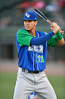Shortstop Jeison Guzman (11) of the Lexington Legends warms up before a game against the Greenville Drive on Saturday, September 1, 2018, at Fluor Field at the West End in Greenville, South Carolina. Greenville won, 9-6. (Tom Priddy/Four Seam Images)