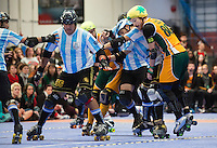 16 MAR 2014 - BIRMINGHAM, GBR - Wizards of Aus jammer Flamin' Galah (right) attempts to avoid being pushed off the track by two Argentine blockers during the inaugural Men's Roller Derby World Cup in the Futsal Arena in Birmingham, West Midlands, Great Britain (PHOTO COPYRIGHT © 2014 NIGEL FARROW, ALL RIGHTS RESERVED)