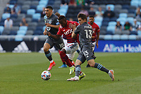 SAINT PAUL, MN - MAY 15: Jader Obrian #7 of FC Dallas and Ethan Finlay #13 of Minnesota United FC battle for the ball during a game between FC Dallas and Minnesota United FC at Allianz Field on May 15, 2021 in Saint Paul, Minnesota.