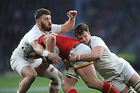 Jonathan Davies of Wales is tackled by Luke Cowan-Dickie and Jack Clifford of England during the RBS 6 Nations match between England and Wales at Twickenham Stadium on Saturday 12th March 2016 (Photo: Rob Munro/Stewart Communications)