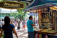 A shopper stands by a stall at the International Market Place in Waikiki.