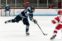 BOSTON, MA - JANUARY 04: Ali Beltz #9 of University of Maine passes the puck during a game between University of Maine and Boston University at Walter Brown Arena on January 04, 2020 in Boston, Massachusetts.