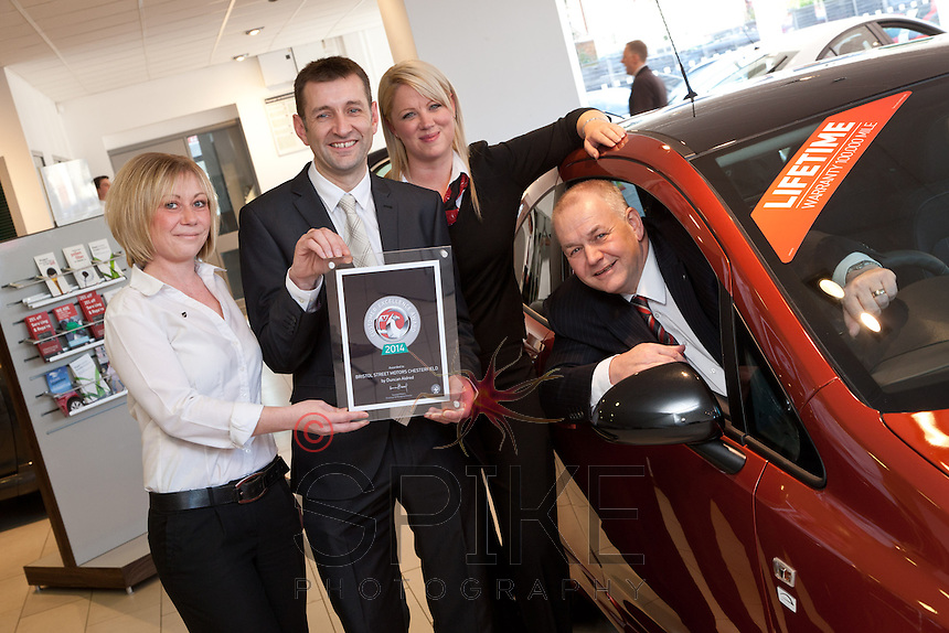 Ian Dodd, Vauxhall Plant Quality Director (second left) presents the Customer Excellence Award to Mike Herring, General Manager watched by Customer Service Champions Amanda Webster (left) and Kathy Kennelly