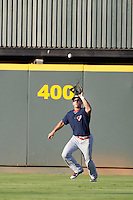 Oklahoma City RedHawks outfielder George Springer (8) makes a catch against the Round Rock Express during the Pacific Coast League baseball game on August 25, 2013 at the Dell Diamond in Round Rock, Texas. Round Rock defeated Oklahoma City 9-2. (Andrew Woolley/Four Seam Images)