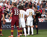 Pictured: Referee Mike Jones (R) moves the Manchester City wall (in red shirts) back for a Swansea free kick. Saturday 04 May 2013<br /> Re: Barclay's Premier League, Swansea City FC v Manchester City at the Liberty Stadium, south Wales.