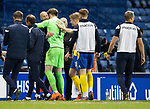 Rangers v St Johnstone…25.04.21   Ibrox.  Scottish Cup<br />Zander Clark hugs saints goalkeeping coach Paul Mathers as they celebrate victory in the penalty shoot out<br />Picture by Graeme Hart.<br />Copyright Perthshire Picture Agency<br />Tel: 01738 623350  Mobile: 07990 594431