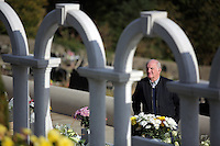 I WAS INFORMED THAT ACCORDING TO THE 1847 CEMETERIES ACT IT IS AN OFFENCE TO TAKE PICTURES IN CEMETERIES<br /> Pictured: A man pays her respects at the Aberfan Cemetery. Friday 21 October 2016<br /> Re: Wales has fallen silent as the country remembered the Aberfan disaster 50 years ago.<br /> On 21 October 1966, a mountain of coal waste slid down into a school and houses in the Welsh village, killing 144 people, including 116 children.<br /> A day of events to commemorate the disaster included a service at Aberfan Cemetery at 9:15am on Friday.<br /> Prince Charles is visiting Aberfan memorial garden before unveiling a plaque in memory of the victims.<br /> He will also attend a reception with the families of some of those who lost their lives, before signing a book of remembrance.