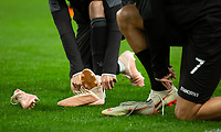 Two of the PAOK players change their boots during training and press conference at Stamford Bridge, London