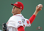Starting pitcher Pat Light (32) of the Greenville Drive works in the first inning a game against the Kannapolis Intimidators on Friday, April 11, 2014, at Fluor Field at the West End in Greenville, South Carolina. Light was a supplemental pick (37th overall_ by the Boston Red Sox in the 2013 First-Year Player Draft. (Tom Priddy/Four Seam Images)