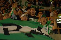TUNJA - COLOMBIA -07 -03-2014: Hinchas, Atletico Nacional anima a su equipo durante partido aplazado de la octava fecha  de la Liga Postobon I-2014, jugado en el estadio La Independencia de la ciudad de Tunja. / Fans of Atletico Nacional encourage for their team during postponed match for the eighth date of the Liga Postobon I-2014 at the La Independencia  stadium in Tunja city, Photo: VizzorImage  / Jose M. Palencia / Str. (Best quality available)