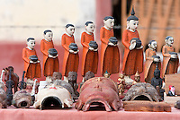 Myanmar, Burma.  Ceramic Figurines of Buddhist Monks Holding Begging Bowls, and Other Buddhist Figures, Inle Lake, Shan State.