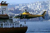 - Financial police, helicopter A 109 inspects a ship in the gulf of Naples ....- Guardia di Finanza, elicottero A 109 ispeziona una nave nel golfo di Napoli