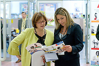 Two staff members on Open Day at Kingston College when prospective students and their parents look around.