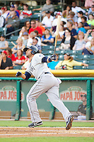 Stefan Romero (11) of the Tacoma Rainiers at bat against the Salt Lake Bees in Pacific Coast League action at Smith's Ballpark on July 8, 2014 in Salt Lake City, Utah.  (Stephen Smith/Four Seam Images)