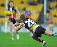 Tom Curren dives for the ball during the ANZAC Day AFL match between St Kilda Saints and Brisbane Lions at Westpac Stadium, Wellington, New Zealand on Friday, 25 April 2014. Photo: Dave Lintott / lintottphoto.co.nz