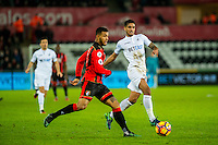 Kyle Naughton of Swansea City  ( right ) moves the ball forwards during the Premier League match between Swansea City and Bournemouth at The Liberty Stadium, Swansea, Wales, UK. Saturday 31 December 2016